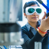 Researcher working with goggles in laboratory.